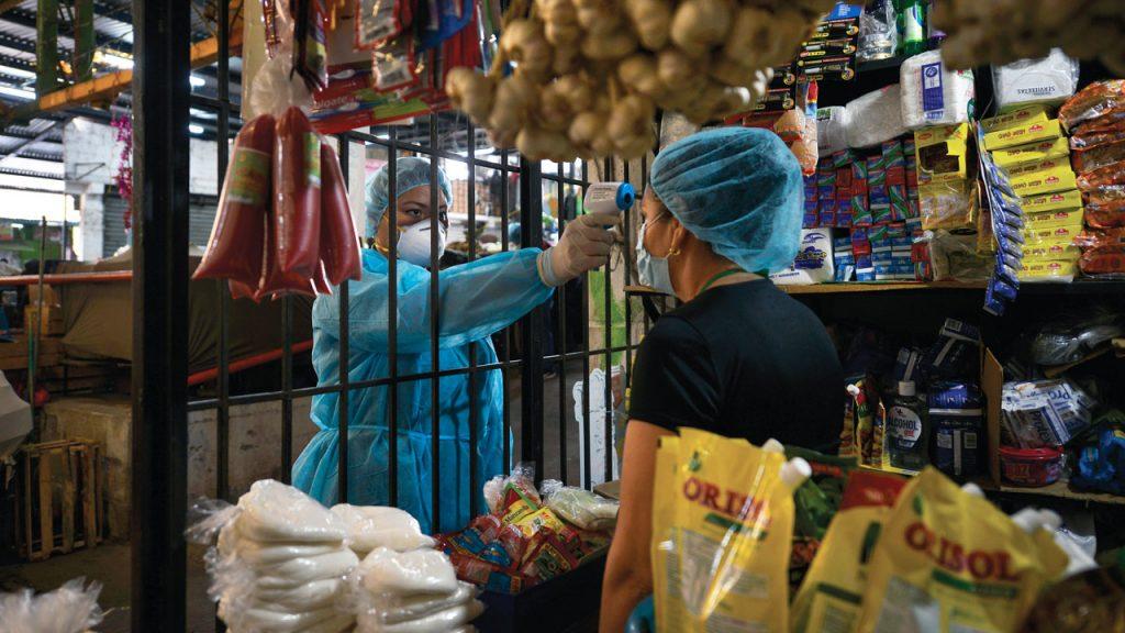 El Salvador Coronavirus negocios Pandemia Covid 19 medidas sanitarias temperatura termómetro